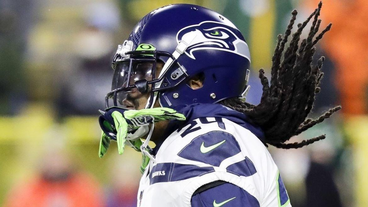 Seattle Seahawks running back Marshawn Lynch gives advice to his fellow players about financial stability