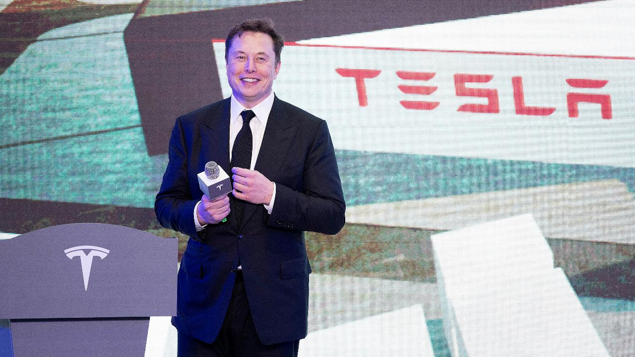 Tesla CEO Elon Musk visits Shanghai plant for the first Model 3 deliveries and breaks out some moves on stage.