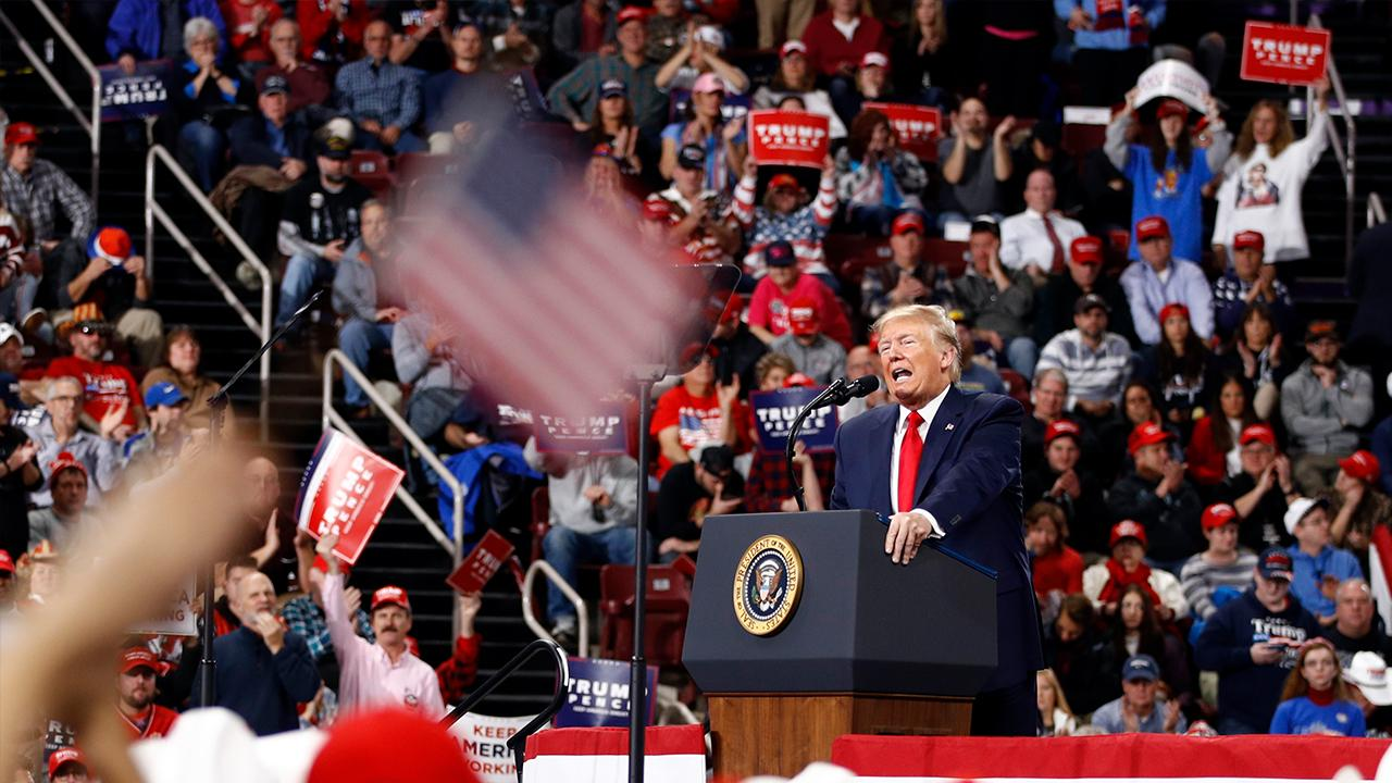 President Trump speaks about rebuilding the U.S. military during a 'Keep America Great' rally in Des Moines, Iowa.