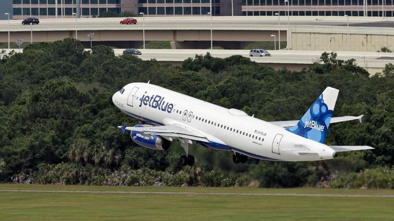 A passenger aboard a JetBlue flight from New York to Florida has tested positive for coronavirus. FOX Business' Susan Li with more.