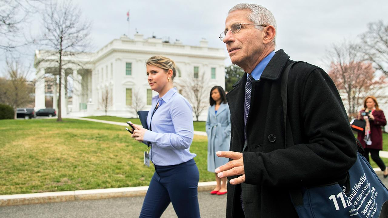 National Institute of Allergy and Infectious Diseases' Dr. Anthony Fauci discusses testing kits for the coronavirus while speaking with reporters on Thursday.