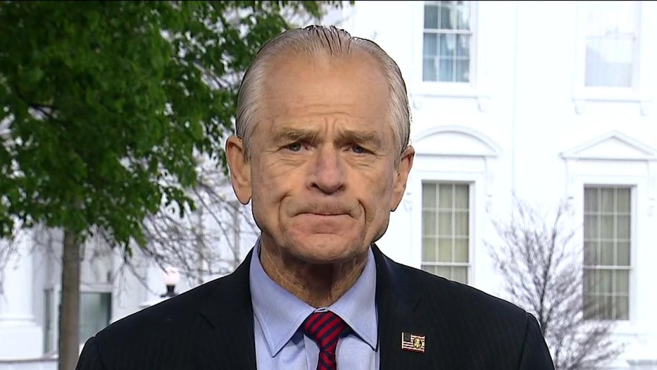 White House trade adviser Peter Navarro says China's hoarding of personal protective equipment is the reason New York City and other hot spots around the world didn't have enough medical supplies during the coronavirus pandemic.
