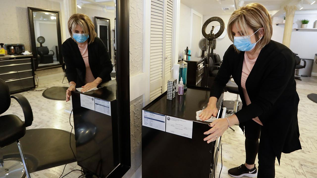 One Indiana salon is reopening with new coronavirus safety protocols, including health questionnaires, temperature checks and masks. FOX Business' Grady Trimble with more.
