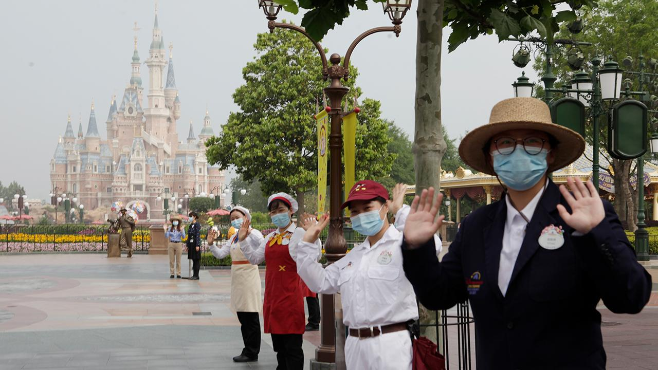 Disneyland Shanghai reopens with new measures including mask-wearing and temperature checks. FOX Business' Lauren Simonetti with more.
