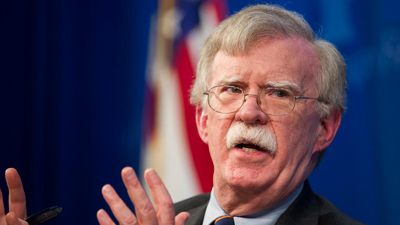 U.S. Attorney General William Barr says former National Security Adviser John Bolton didn't have classified information removed from his book before its publication.