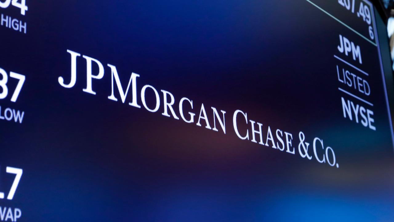 Bloomberg News is reporting half of JPMorgan Chase traders will return to New York offices in July.