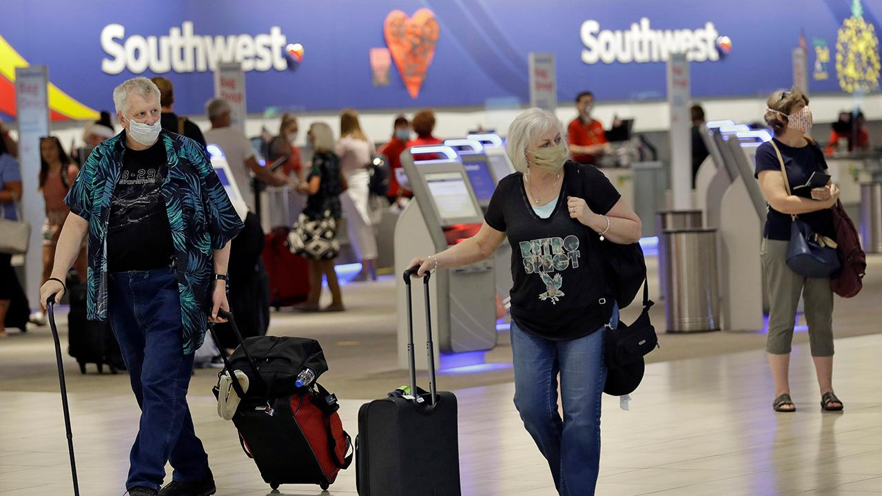 Tampa International Airport CEO Joe Lopano weighs in on how airports can ensure travelers' safety and confidence in the coronavirus-era, including measures they took such as social distance stickers, Plexiglass, and cleaning more often.