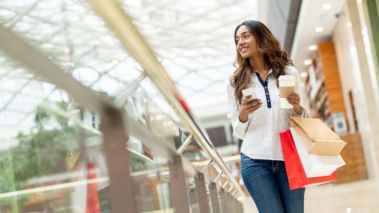 Kristina Partsinevelos talks with Black Friday shoppers
