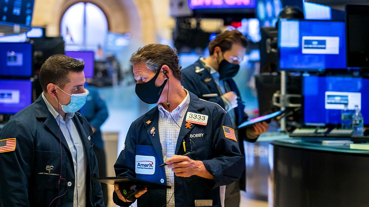 Fox News contributor John Layfield gives his take on the market, arguing 'conflicting forces' are causing stocks to drag.