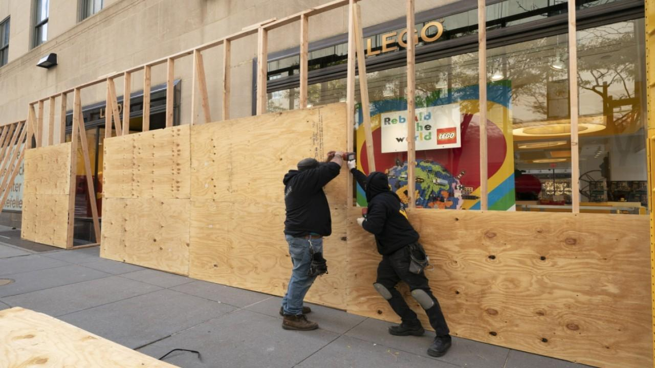 Businesses across New York City are being boarded up in case of election unrest. FOX Business' Kristina Partsinevelos with more.