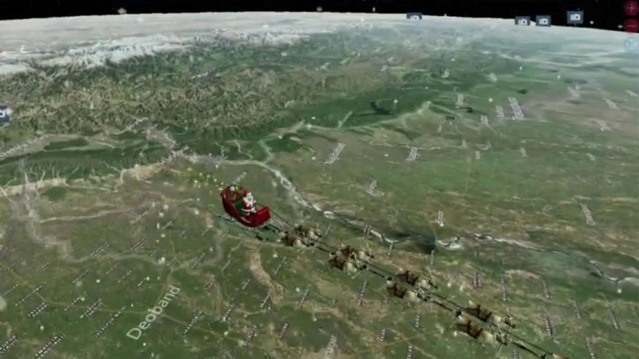 Vice Admiral Michael J. Dumont, U.S. Navy Northern Command Deputy Commander, gives an update on where Santa is across the world using NORAD technology like radar and satellites.
